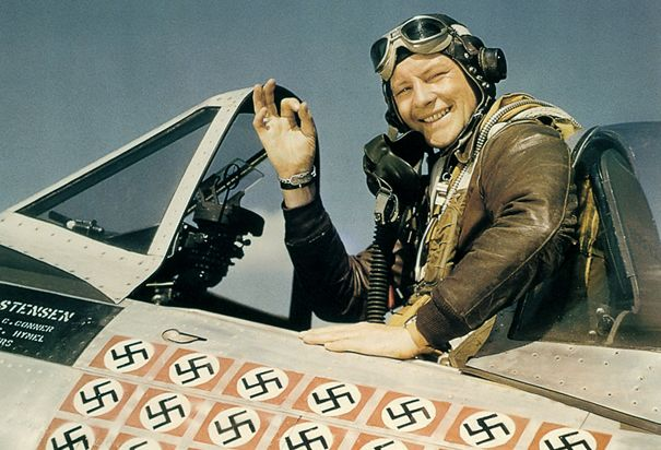 World War II Fighter Pilot : American ace fighter pilot Captain Fred J. Christensen in the cockpit of his P-47 Thunderbolt fighter, c.1944. Each of the 22 swasitkas painted on the fuselage of the plane represents a German aircraft destroyed.
