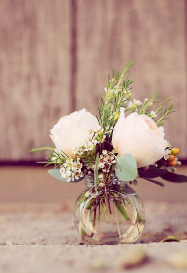 Peach Rosebuds And Wax Flowers In A Bud Vase