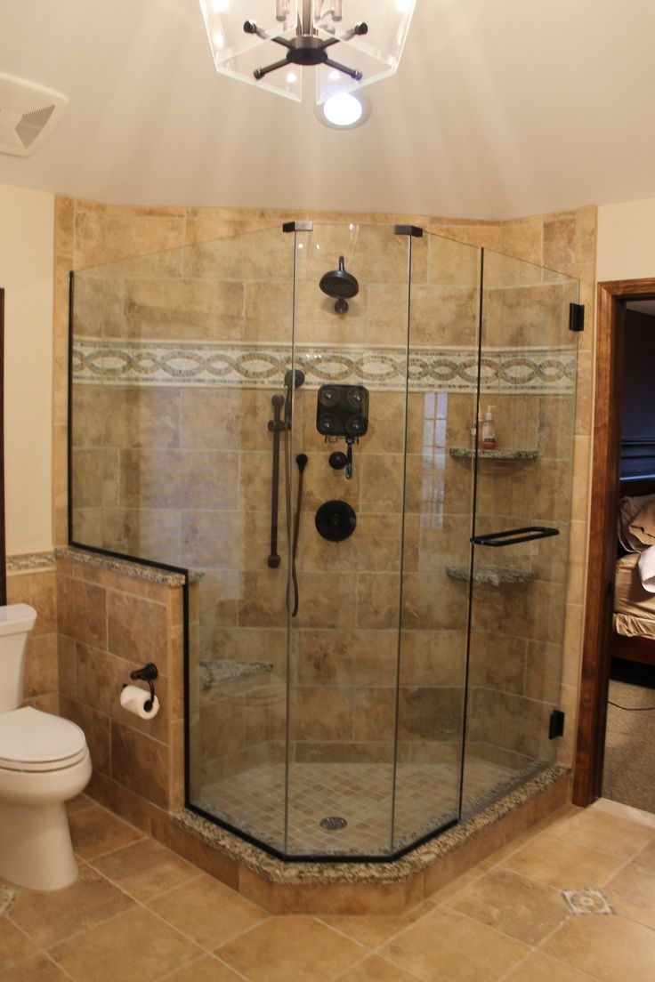 Tiled shower with easy storage access for bath towels. Description ...