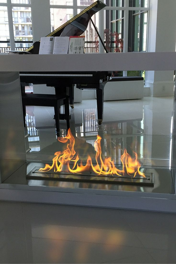 This Free Standing Ethanol Fireplace Is Sleek And Edgy It Can Be Placed Anywhere As It Doesn T Require Any S Home Fireplace Ethanol Fireplace Modern Fireplace