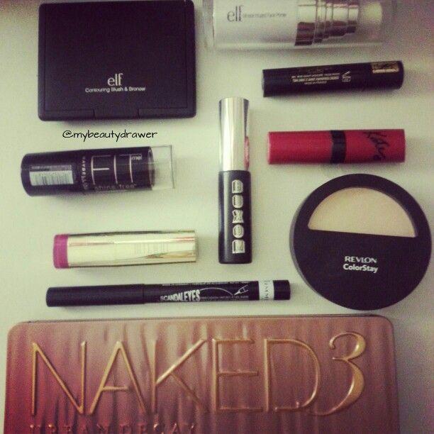 Makeup of the day.  #makeup #motd #fotd #makeupmess #makeupporn #elf #blush #bronzer #primer #maybelline #milani #lipstick #rimmel #rimmellondon #scandaleyes #liquidliner #urbandecay #naked3 #eyeshadow #palette #katemoss #buxom #mascara #mini #sample #revlon #ysl
