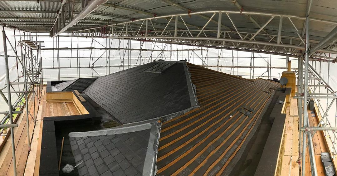 Great Picture From Inside The Big Temporary Roof For Lead Work And Solar Panels To Be Installed Acs Workingatheights Brickwork Brick Laying Solar Panels