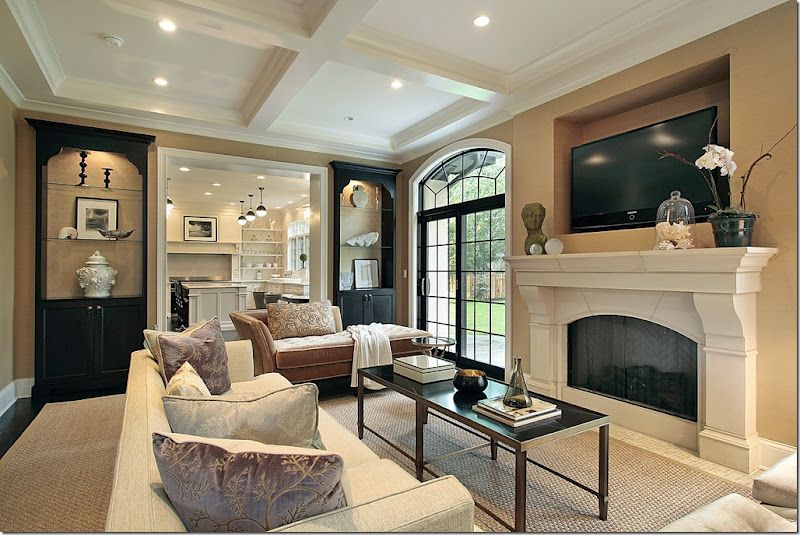 Living Room Khaki Walls White Trim Black Built Ins Ceiling Beams.
