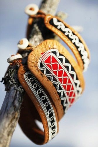 Sami bracelets: tin embroidery on reindeer leather, reindeer antler button Finland
