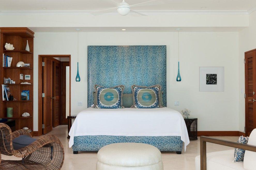 sparkling teal headboard with blue upholstered louvered doors