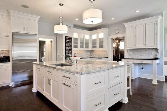 Opposite View Of Kitchen Refrigerator Drawers In Island And Hidden Dishwasher Dark Kitchen Floors Hardwood Floors In Kitchen White Kitchen Cabinets