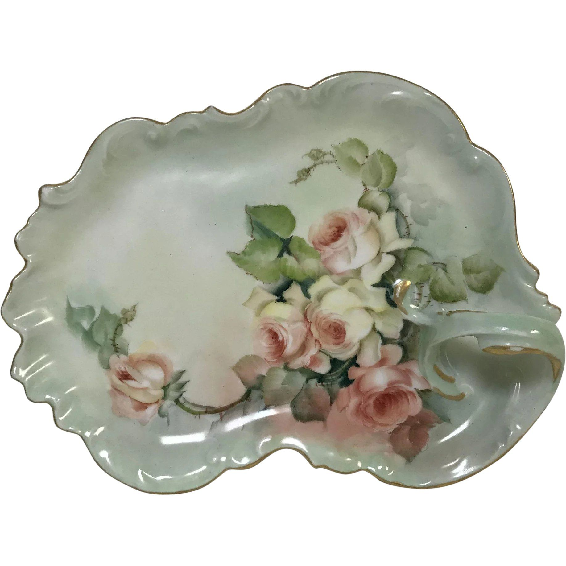 Limoges porcelain leaf shaped vanity tray with gold rim and hand