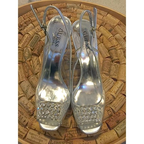 """GUESS by Marciano Clear slingback Heels 6.5 Parting with my wedding shoes!  Beautiful open-toed, sparkly, Cinderella like """"glass slippers"""". Only worn once.  Barely any signs of wear.  Size 6.5. Heel height = 4.25 inches.  Clear upper and silver heel Guess by Marciano Shoes Heels"""