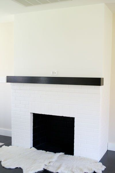 We are currently working on updating the living room in our 1950s rancher and started by giving the red brick fireplace a makeover with some white paint and a n…