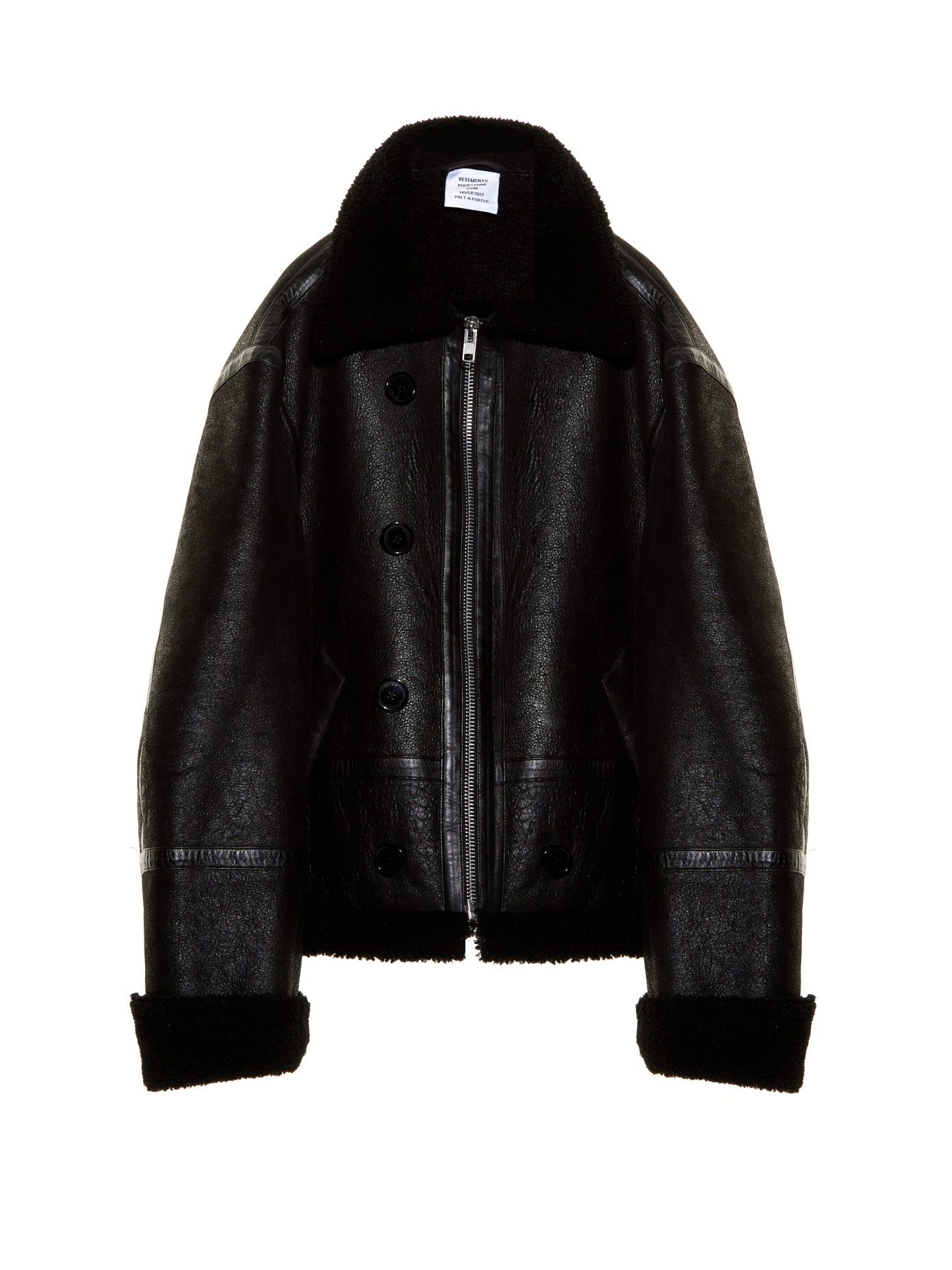 0764e513 Adopt Vetements's exaggerated silhouettes with this oversized black shearling  jacket. It has a grained-leather exterior that gives way to a fuzzy lining  and ...