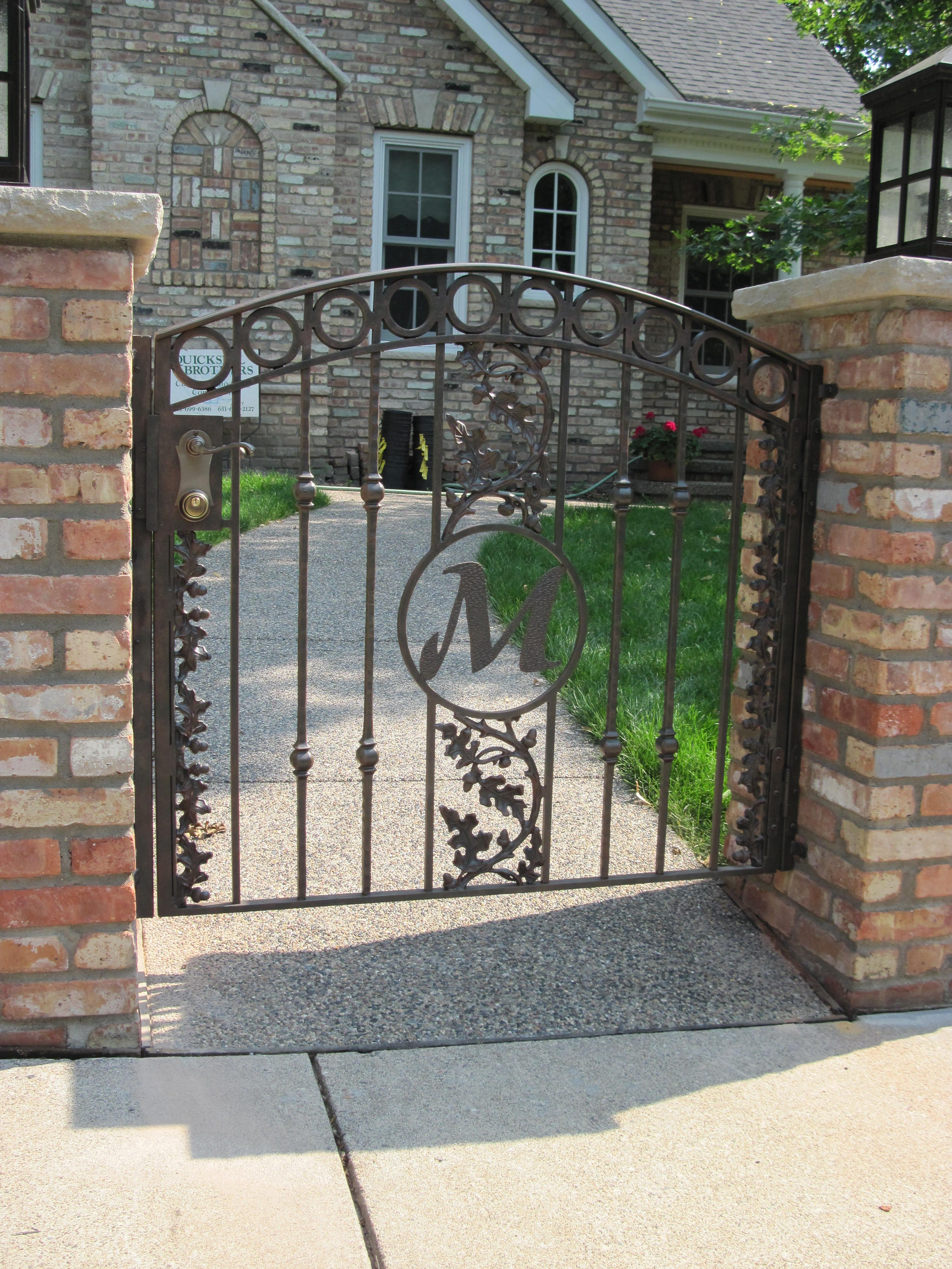 Arched Top Iron Gate With Forged Spokes Oak Leaf Design