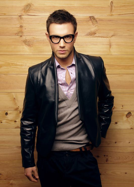 8355798c1b67 The deep v-neck sweater and unbuttoned plaid dress shirt make for casual  sophisticated look.