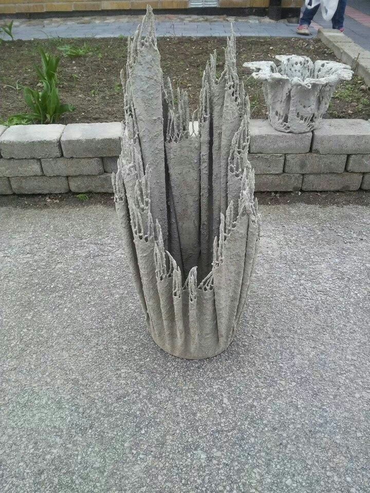 Tablecloth dipped in concrete and hung over suitable