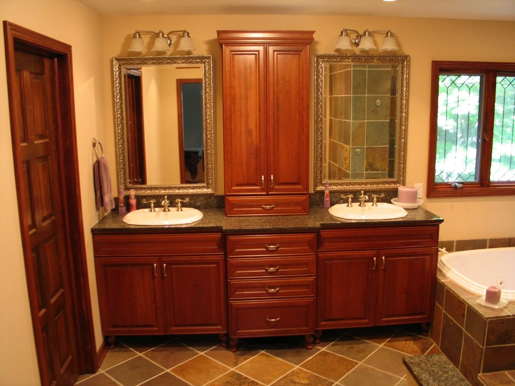 Double Vanity With Upper Linen Cabinet In The Middle For
