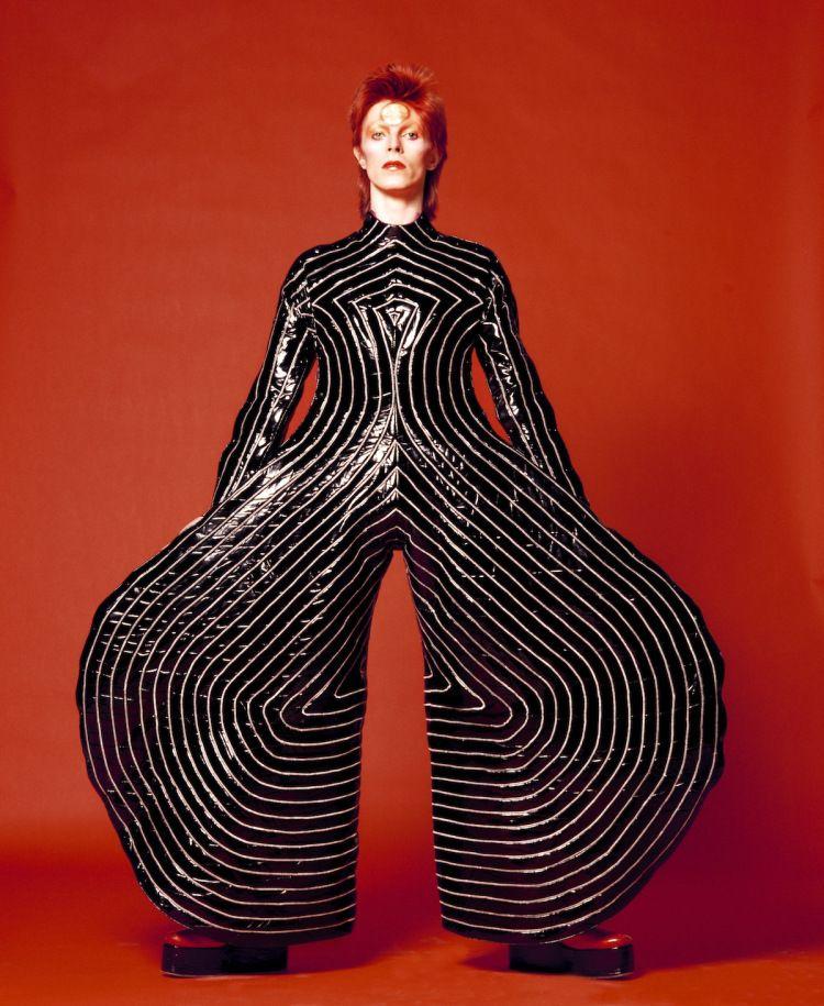 "David Bowie in the ""Tokyo Pop"" vinyl bodysuit that Kansai Yamamoto designed for his Aladdin Sane tour, 1973. Photo Masayoshi Sukita"