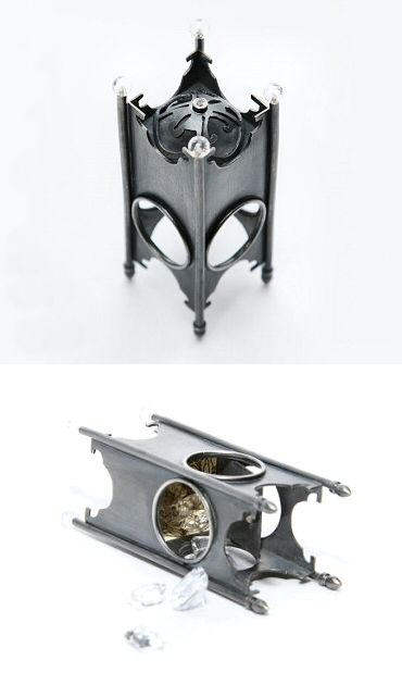 """UK metalsmith Hannah Livingston.  """"Casket"""" ring in oxidized sterling, crystal, white topaz and Florentine paper."""