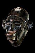 Tanzania, Makonde  wood, slightly shiny, blackish brown patina, of oval hollowed form, marked by a voluminous disc-shaped lip plug and big p...