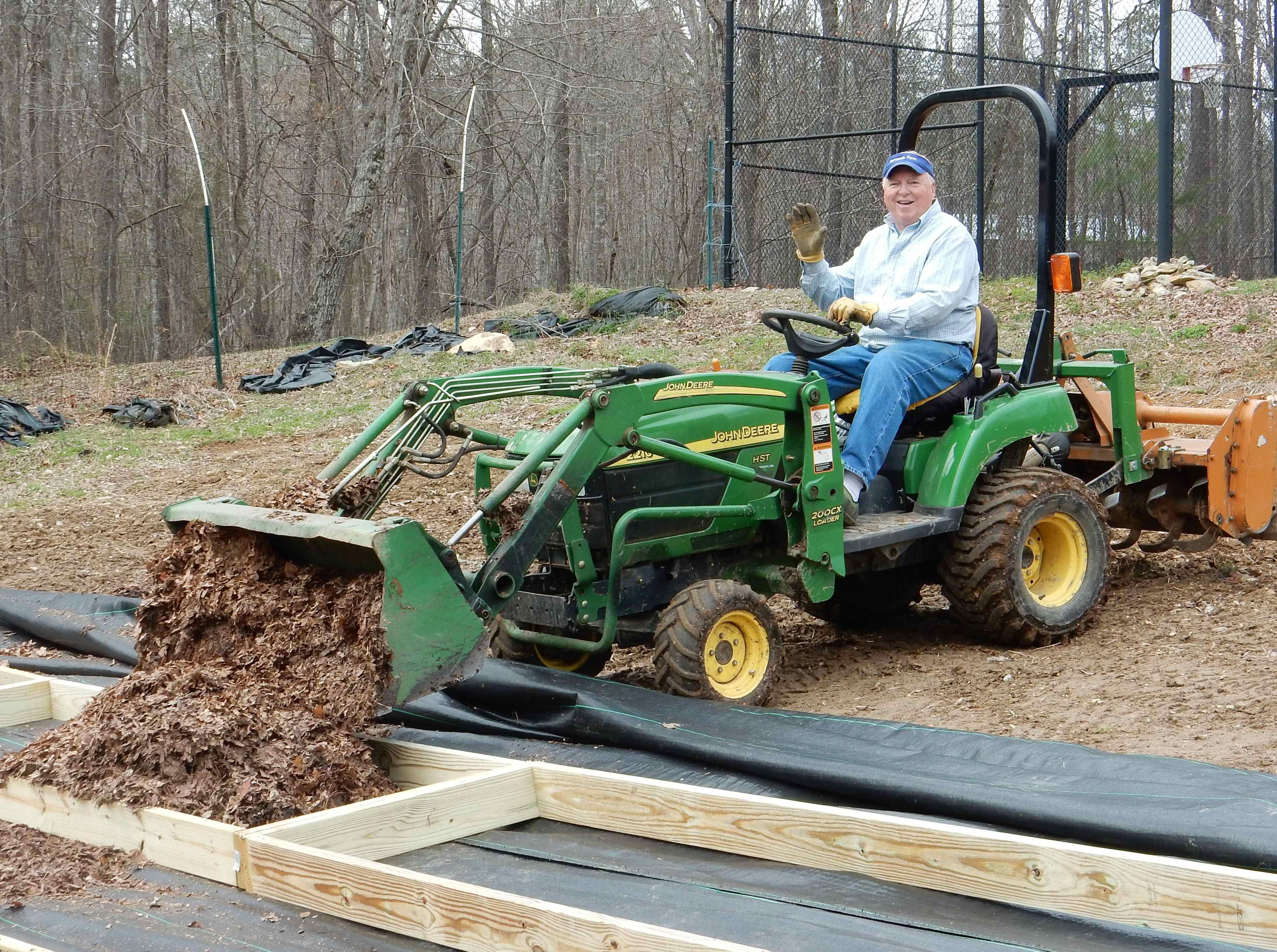 Bill is filling raised beds with composted leaves and soil