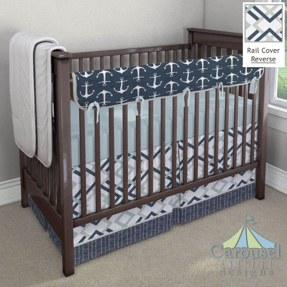 Crib bedding in Solid Robin's Egg Blue, Navy Anchors, Navy and Gray Geometric, Solid Silver Gray, Navy Herringbone. Created using the Nursery Designer® by Carousel Designs where you mix and match from hundreds of fabrics to create your own unique baby bedding. #carouseldesigns