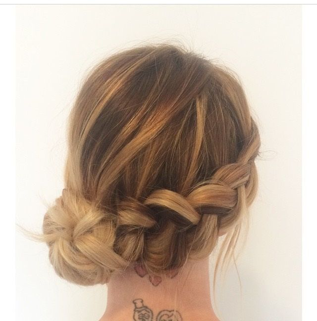 Braid With A Low Side Knot Bun.