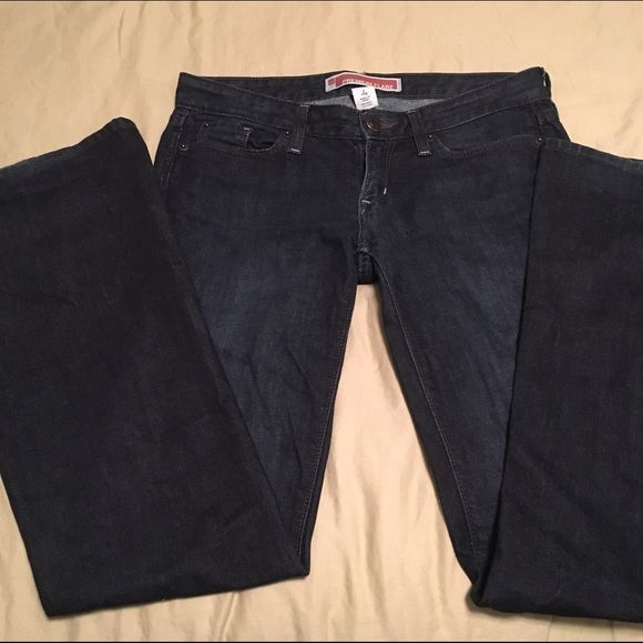 """GAP flare jeans Dark wash flare jeans. Excellent condition. Only flaw is the tiny wear on hem (see last picture). 32"""" inseam 7"""" front rise 13"""" back rise GAP Jeans Flare & Wide Leg"""