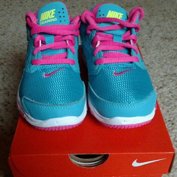 Nike Girls Shoes New in box girls Nike shoes size 11C. Colors are pink,