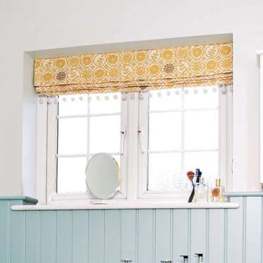 Dress Up Unadorned Bathroom Windows With Fabric Roman Shades In An Eye Catching Pattern