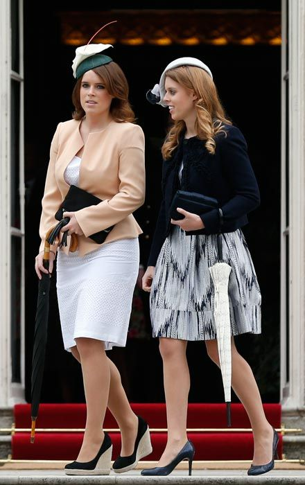 (R-L) Princess Beatrice and Princess Eugenie at Queens summer garden party at Buckingham Palace, 30 April 2013.