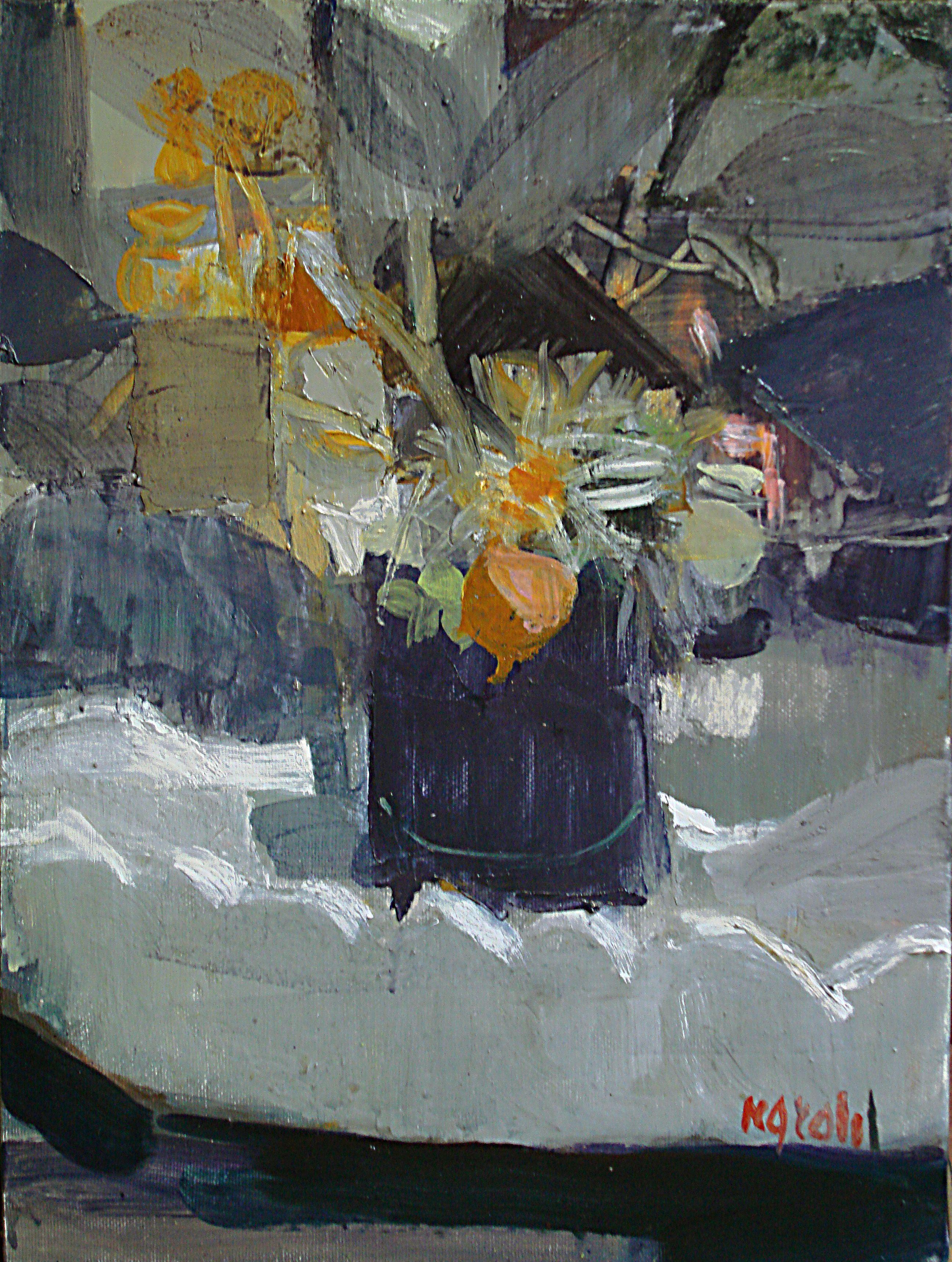 Vasetto nero con fiori secchi
