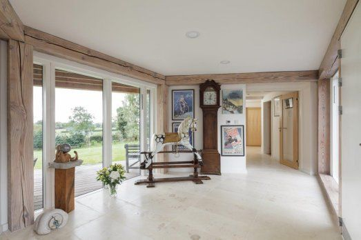 Low Key Entrance Hall In New Timber Frame House With Exposed