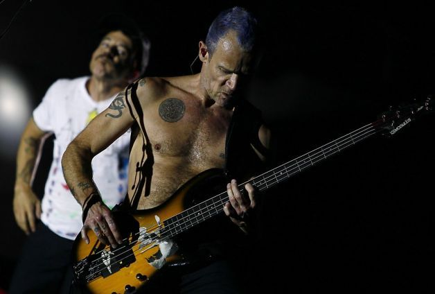 """Singer Anthony Kiedis and bassist Mike """"Flea"""" Balazary perform with the Red Hot Chili Peppers last month at the Rock in Rio music festival on the outskirts of Madrid. The L.A. band has been blending funk and rock for 30 years. Photo: Andres Kudacki, Associated Press / SF"""