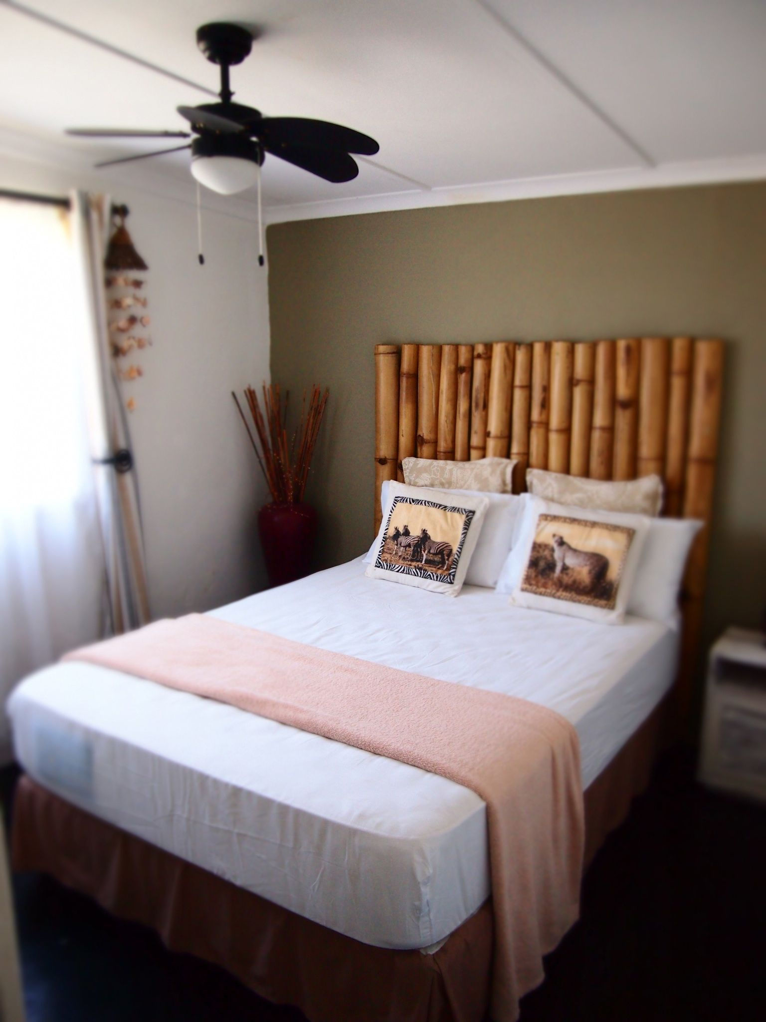 The Bamboo Room Has A Bamboo Headboard And Mirrors Made Of