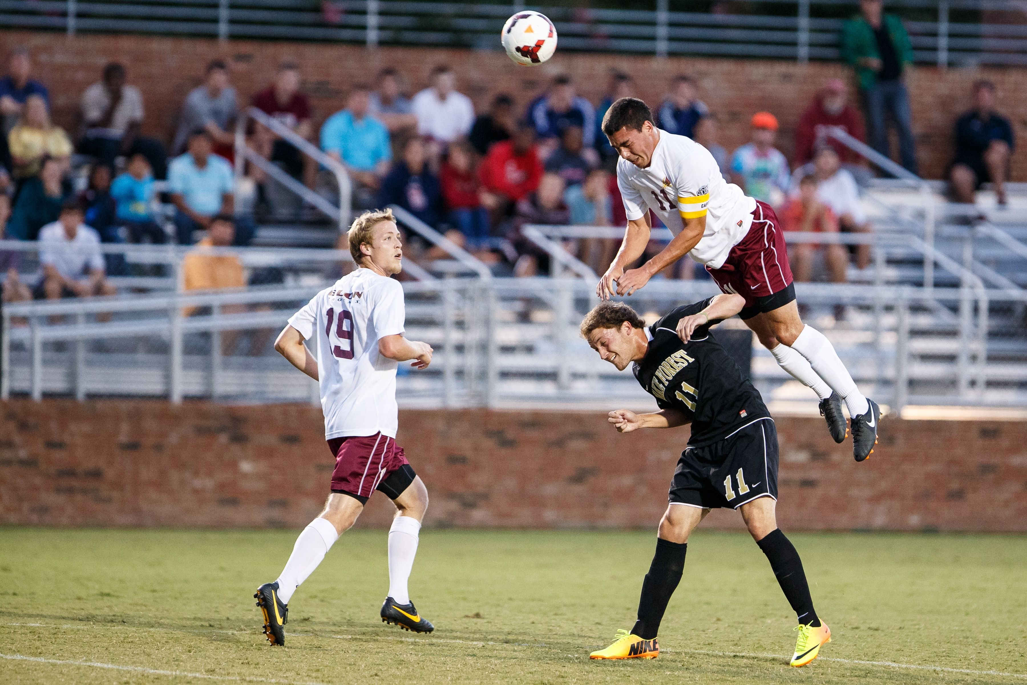 Up Up And Away Elon Midfielder Daniel Lovitz Goes Over A Wake Forest Player To Win A Header University Athlete Midfielder Athlete