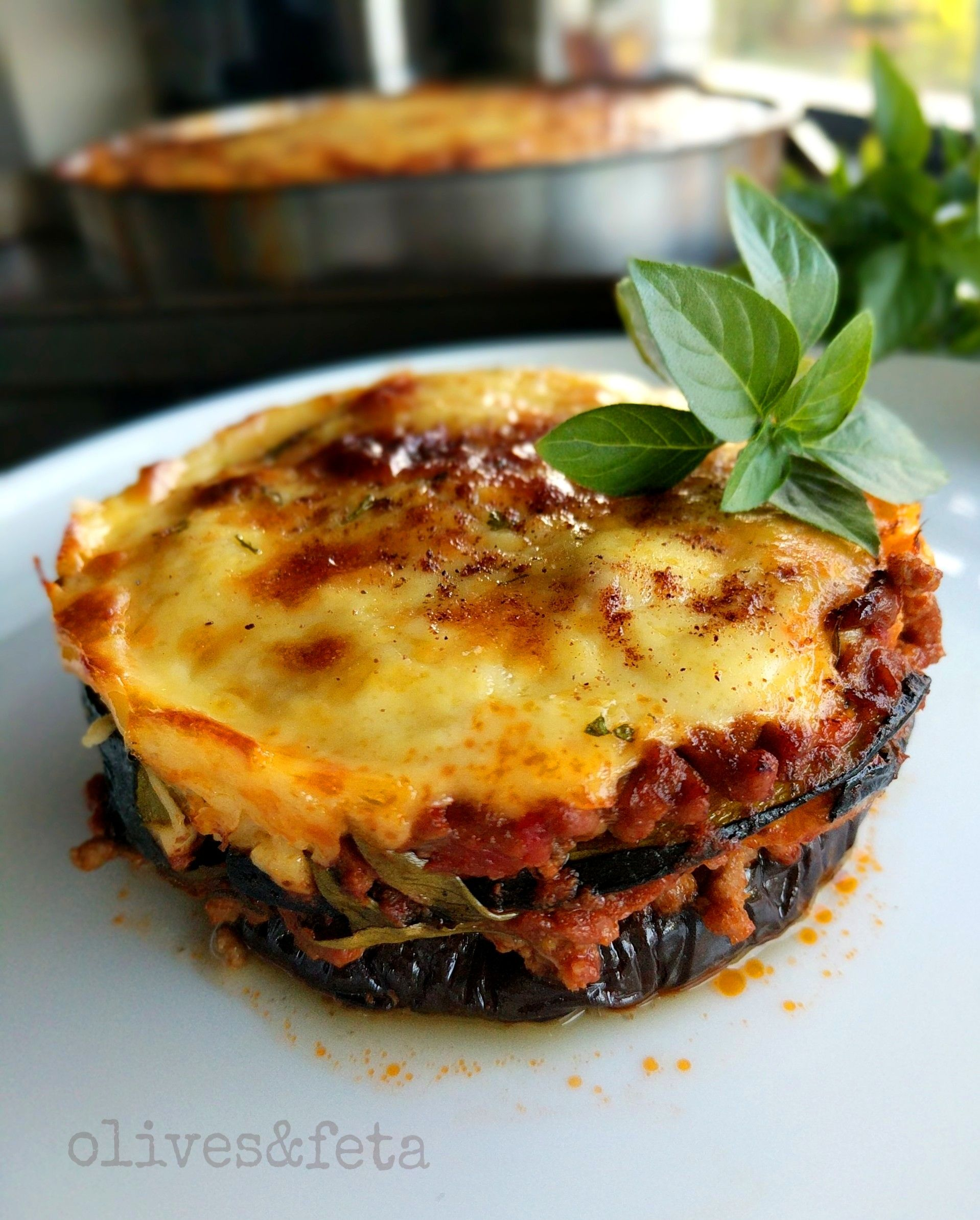 A Delicious Variation Of The Traditional Moussaka The Eggplant And Zucchini Layers Alternate With A Smooth Herbed Tomato And Moussaka Recipe Moussaka Recipes