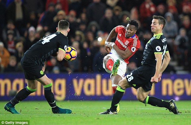 Gary Cahill gets his body in the way of a shot from Adama Traore as the Blues stood firm