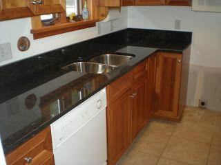 A Mesabi Black Granite Countertop Install Black Granite Kitchen Countertops Black Countertops Black Kitchen Countertops