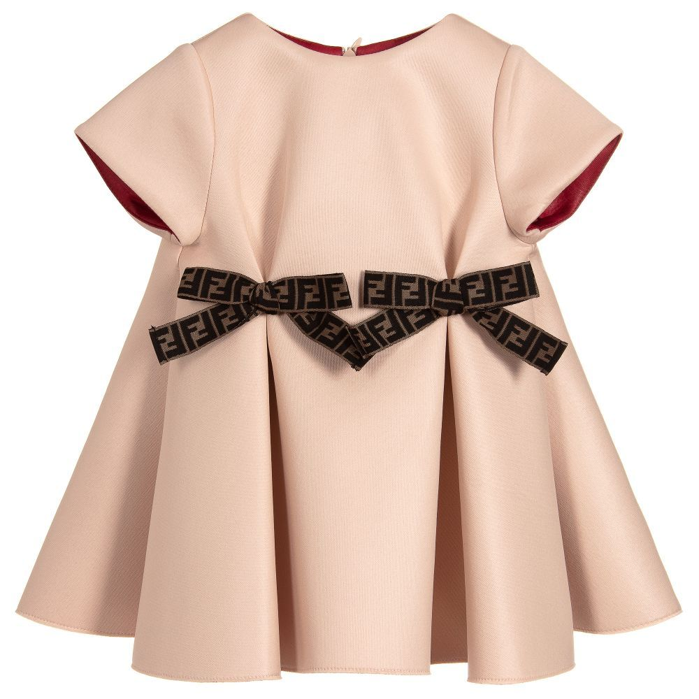 9bd44093e3bad Baby girls pink dress by Fendi, with brown detachable 'FF' logo bows. Made  in soft mid-weight neoprene, with pleats on the front that flow into a  beautiful ...