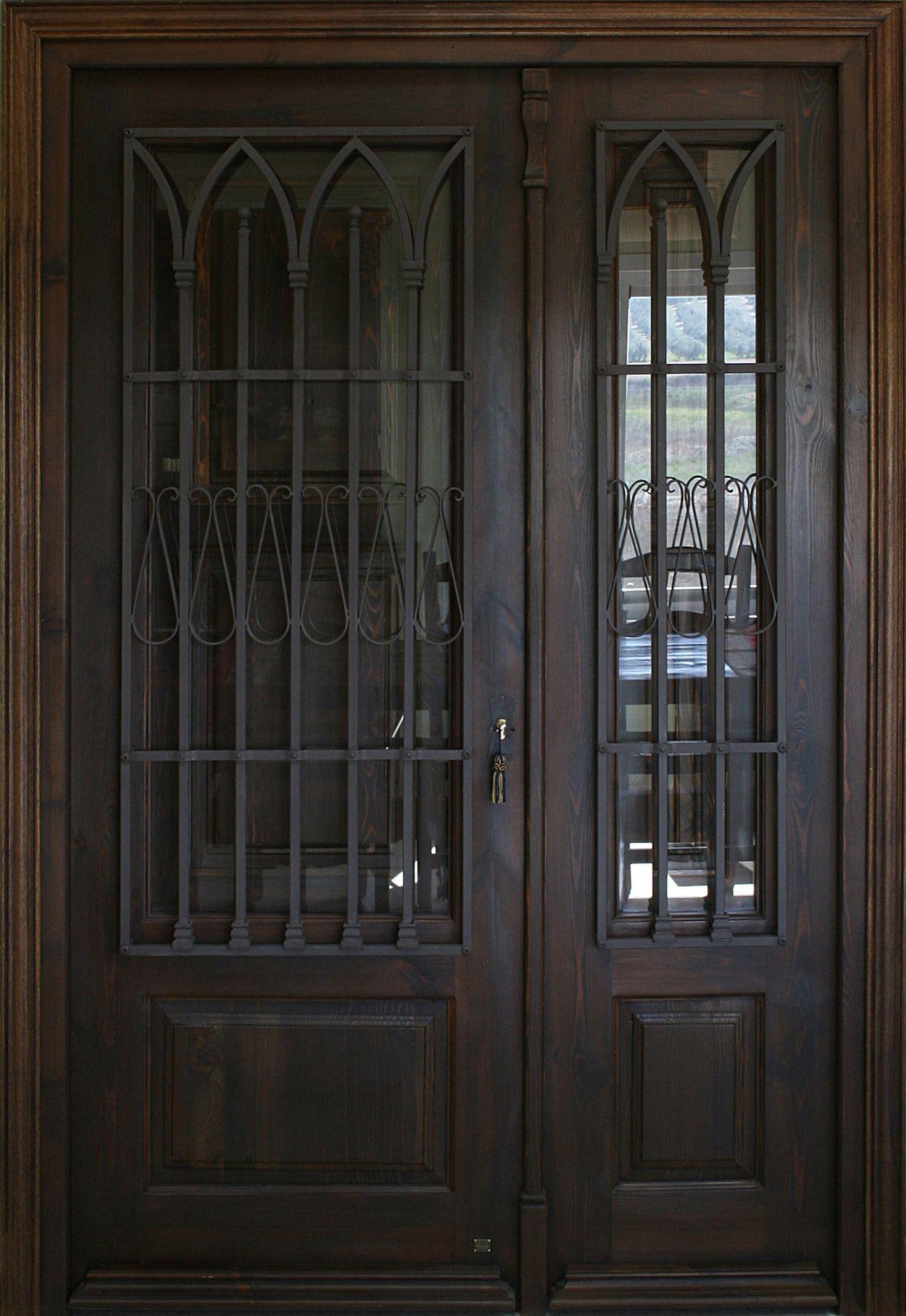 Puerta de estilo modernista de una hoja y fijo lateral con - Rejas de hierro forjado ...