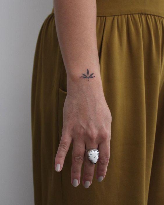 Minimal leaf tattoo on the wrist | www.otziapp.com