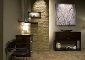 Faux rock panels are much easier to work with than the real thing when it comes to mounting a shelf and a shadow box.