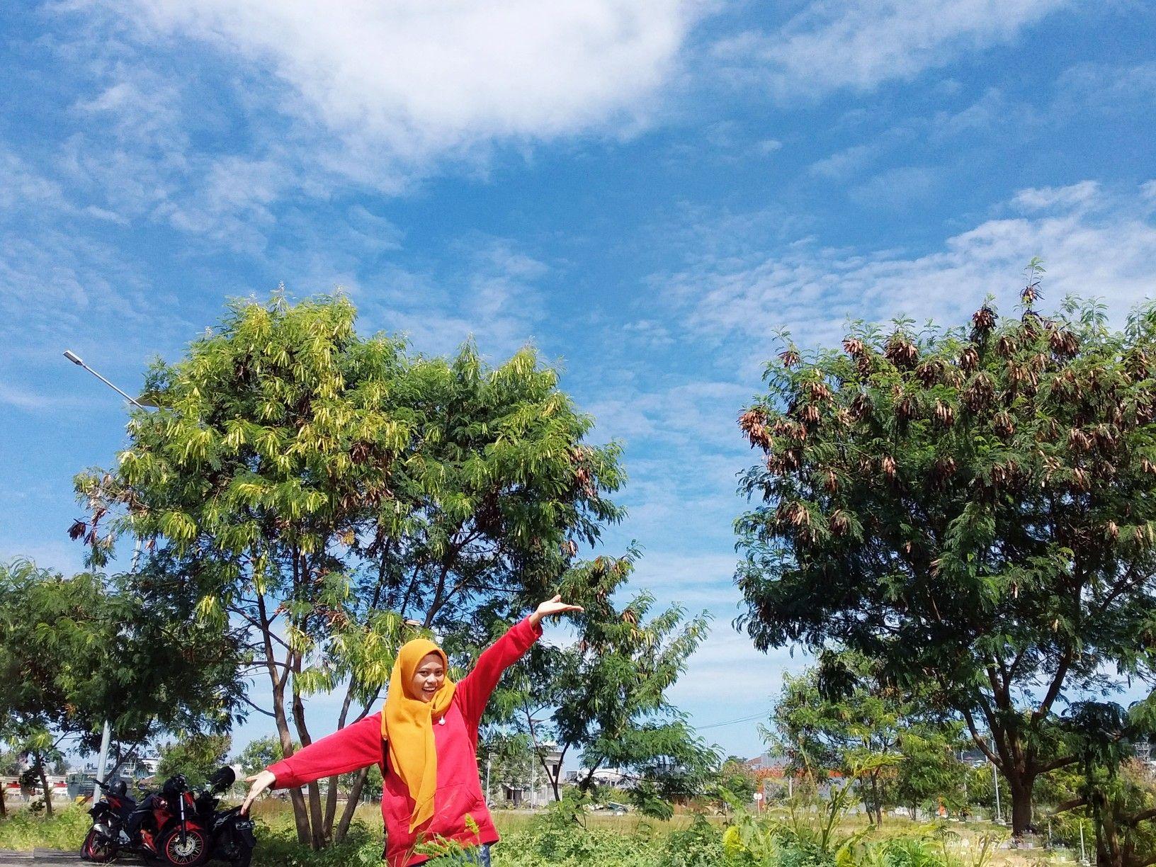 Happy Noviyana Shiali Girl Under The Blue Sky Green Nature.
