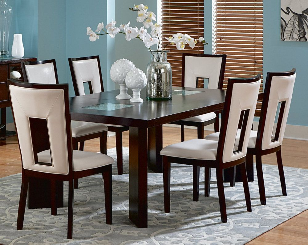Chic small dining room idea with simple modern 7 piece dining table and chairs in two tone also white flowers centerpiece and flourish area rug also blue