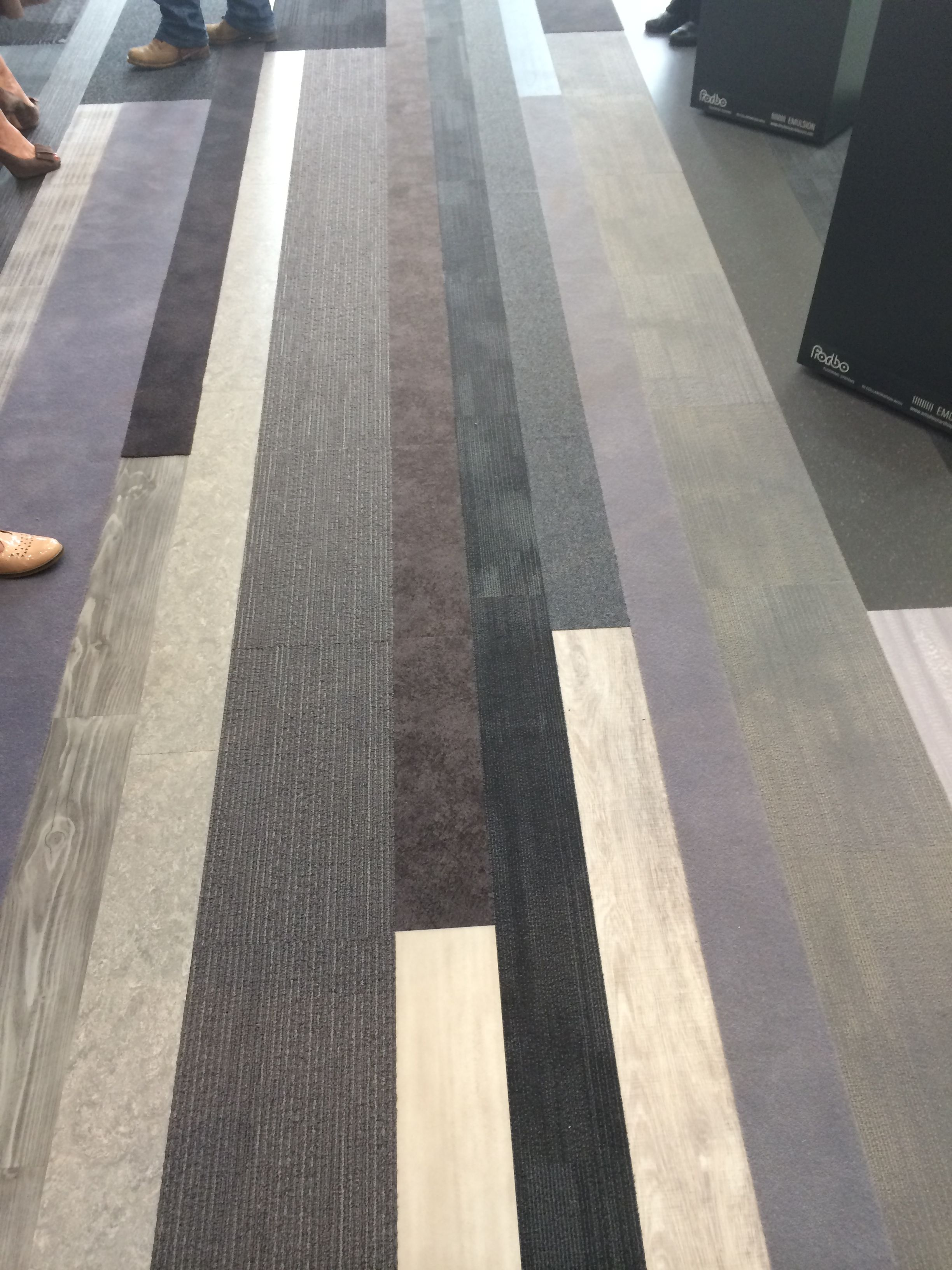Vinyl planks and carpet tiles installed together to create visual vinyl planks and carpet tiles installed together to create visual sensation doublecrazyfo Choice Image