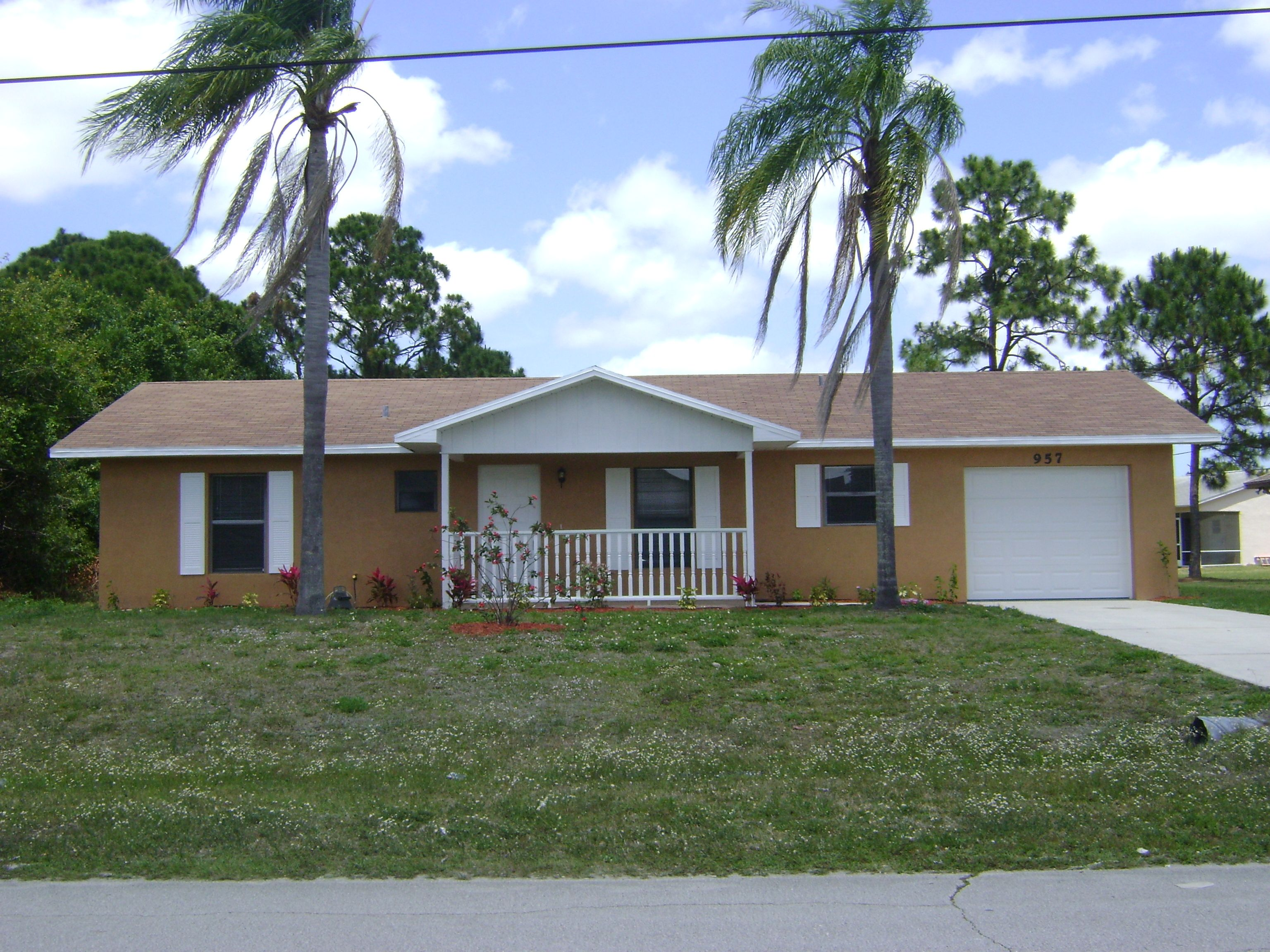 957 SW Alexandria Ave. Cozy little home for an upstart couple or emptynesters. Nestled in a quiet neighborhood in the heart of Port Saint Lucie, FL. Very close to Tradition for shopping and dining needs. $98,900 SOLD