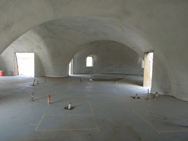 Inside an unfinished Monolithic dome home  I would love to