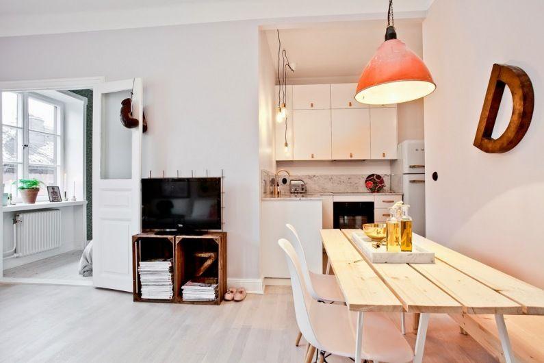 We Wnece Przy Pokoju Dziennym Zaaranzowano Kuchnie Nie Ma W Niej Okna Jednak Bliskosc Rozswietlonego S Home Modern Furniture Living Room Tiny House Community