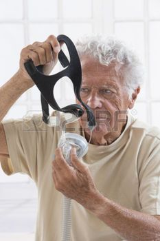 respiratory tract: Adult Man Adjusting CPAP Mask for sleep ...