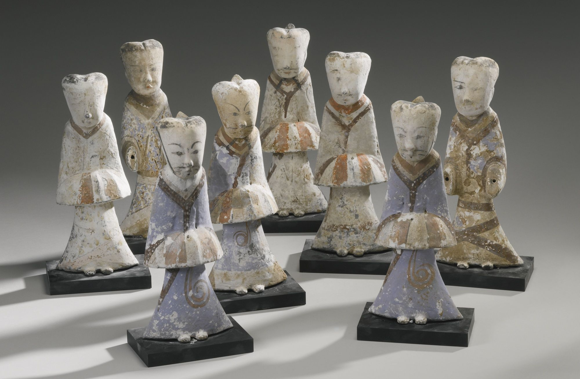 EIGHT PAINTED GRAY POTTERY FIGURES OF ATTENDANTS, HAN DYNASTY | Lot | Sotheby's