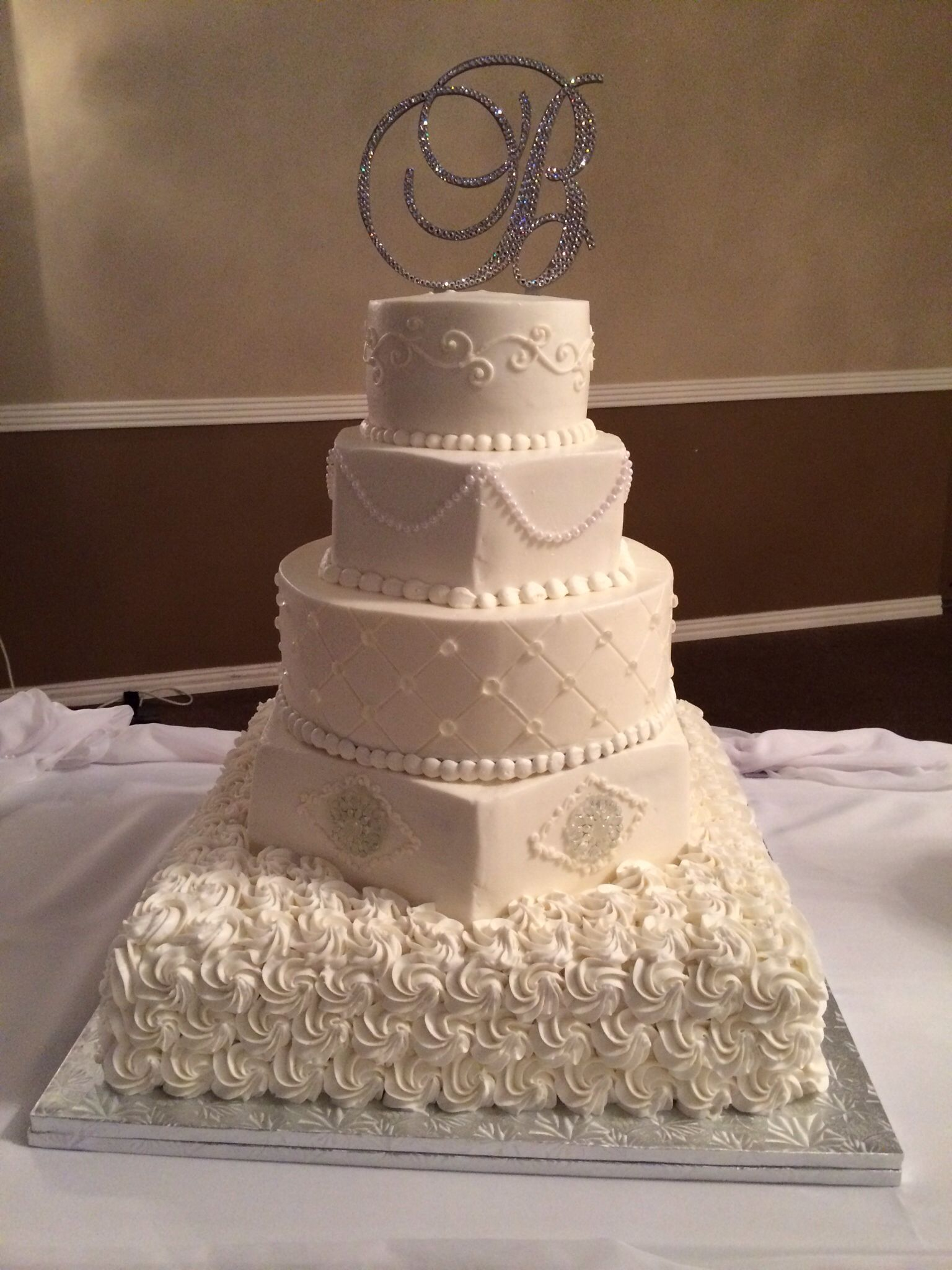 Beautiful White Cake With A Bling Monogram On Top Bowdenwedding Preciselyasplanned