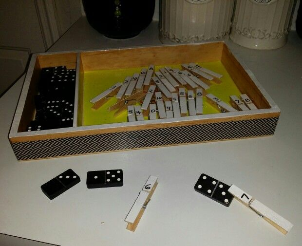 """Addition: """"Domino Math"""" for first grade or ESE. Old dominoes and clothespins. Love!"""